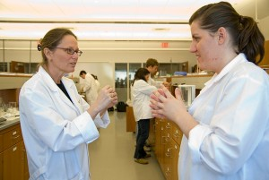 <p>Professor Robin Bogner, left, Teaching Fellow, speaks with Anisa Naka, a fifth-year pharmacy student. Photo by Jessica Tommaselli.</p>