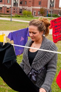 <p>Desiree DiLanno examines T-shirts in the Clothesline Project. Photo by Frank Dahlmeyer</p>