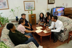 <p>Students from the School of Social Work meet with residents at Mary Mahoney Village in Hartford. From left, Erika Cruz, Lisa Figueroa, Detra Varner, and Christopher Parker. Photo by Peter Morenus</p>