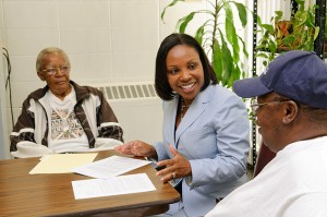<p>Karen Bullock, associate professor of social work, meets with residents at Mary Mahoney Village in Hartford. Photo by Peter Morenus</p>