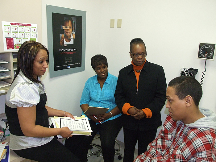 From left, system navigator Delita Rose-Daniels, case manager Monica Carr, ...