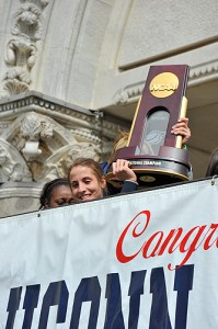 <p>Caroline Doty holds the trophy at the start of the parade in downtown Hartford to celebrate the Women's Basketball team's NCAA championship win. Photo by Peter Morenus</p>