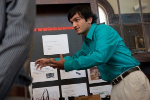 <p>Electrical Engineering major Hetul Patel explains to visitors his Electrocar senior design project at a convention in Wilbur Cross Library on April 30, 2010. Photo by Lauren Cunningham</p>