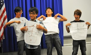 "<p>How many meanings does ""six pack"" have in English? These UCAELI students from Taiwan show off their newly acquired English language skills at closing ceremonies. Photo by Peter Morenus</p>"