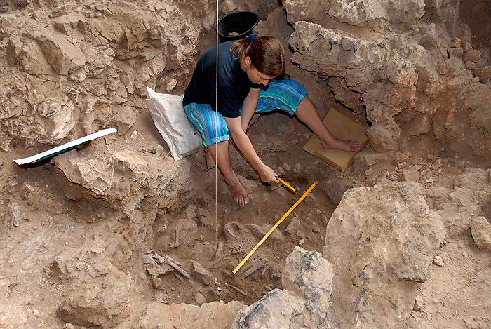 <p>Natalie Munro excavating the grave of a unique woman interpreted as a shaman at Hilazon Tachtit Cave, Israel.  The grave contained the remains of at least 71 tortoises that were feasted on by humans as part of the burial ritual. Photo by Photo by Naftali Hilger</p>