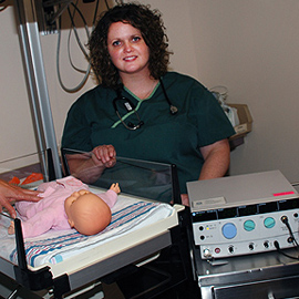 <p>Neonatal Intensive Care nurse Kathryn Ireland during a demonstration of a laser eye procedure. Janine Gelineau</p>