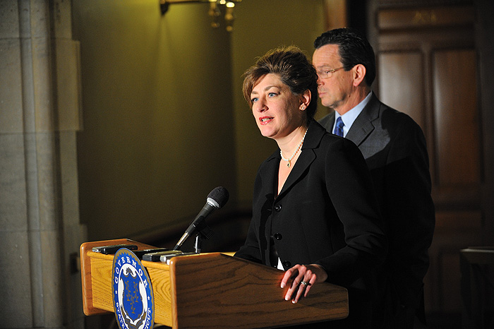 <p>President designate Susan Herbst speak to the media after a meeting at the Governor's office. At right is Governor Dannel P. Malloy. Photo by Peter Morenus</p>