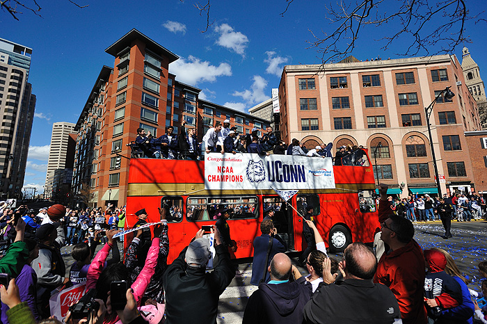 <p>Thousands of people lined the streets of downtown Hartford on April 17th, waiting for a chance to cheer on the NCAA National Champion UConn Huskies.  When Hall of Fame head coach Jim Calhoun addressed the crowd he said: I just want to tell you ... this is our third trip up here and it doesn't get old. Our fans are the No. 1 fans in all of America. Photo by Peter Morenus</p>