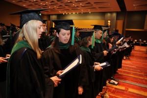 Medical graduates recite the Hippocratic Oath.