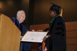 Dr. Marja Hurley receives the 2011 Board of Directors Faculty Recognition Award from Board Chair Gerard Burrow.