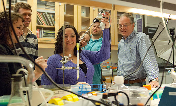 Graduate students, from left, Kathryn Pietrosimone, Ryan Molony, and Clare Melchiorre; undergraduate Meaghan Roy-O'Reilly, a University Scholar; and graduate student Peter Reinhold in the lab with Professor Michael Lynes.