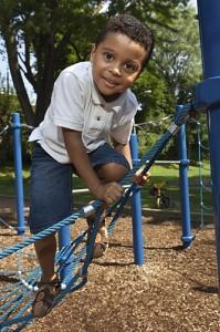 Child on Playground (Shutterstock Photo)