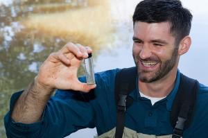Mark Urban examines plankton in a test tube.