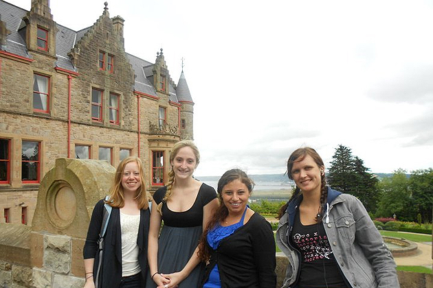 From left, UConn students Grace Vasington, Savannah Williams, Rachael Nave, and Dovile Vilkauskaite on a visit to Belfast Castle during their trip to Ireland to attend the U21 summer school.