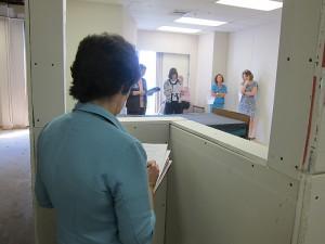 Nursing manager Donna Pryor fills out an evaluation form about the patient room mock-up. (Jennifer Beardsley/UConn Health Center Photo)