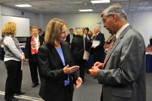 Mary Holz-Clause, left, vice president for economic development, speaks with Suman Singha, senior vice provost and vice president for research. (Peter Morenus/UConn Photo)