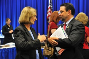 Mary Holz-Clause, left, vice president for economic development, speaks with Steven Reviczky, state commissioner of agriculture.