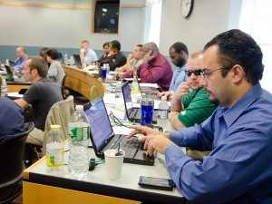 Joseph Nunez, forground, is a graduate of the 2010 EBV at UConn. Seated next to him, wearing a green shirt, is Michael Zacchea, a veteran who directs the UConn program.