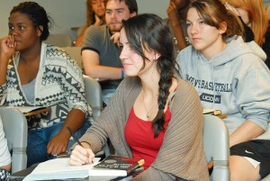 Rachel Donnelly '15 (CLAS), foreground, participates in an FYE Humanities Seminar taught by Cathy Schlund-Vials, faculty director of Humanities House.