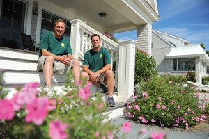 Harlan Hyde '99 (RHSA) and Brandon Hyde '01 (CANR) of Hyde Park Landscaping show their work at a beachfront house in Groton Long Point.  (Peter Morenus/UConn Photo)