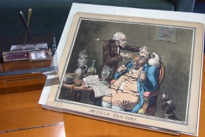 British caricaturist and printmaker James Gilray's farcical portrayal of a physician using metallic tractors on a patient is featured as a comical piece in the Hartford Medical Society Historical Library's newest exhibit at the UConn Health Center.