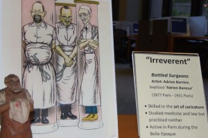 """Under the category of """"irreverent,"""" French caricaturist Adrien Barrère's """"Bottled Surgeons"""" is among the artwork on display in the Health Center's L.M. Stowe Library."""