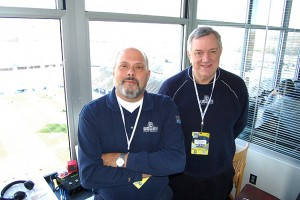 Joe D'Ambrosio, left, and Wayne Norman, in the WTIC/UConn Radio Network booth high above Rentschler Field. (Kenneth Best/UConn Photo)