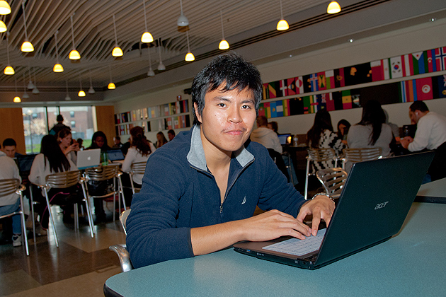 Pei-Kang Wu works on his laptop in the School of Business Cafe on Nov. 30, 2011. (Ariel Dowski/UConn Photo)