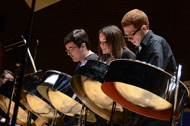 Alexander Gaffney, left, Luci Chaplin, and Ryan Royle perform at the Steel Pan Ensemble held in von der Mehden Recital Hall on Dec. 4, 2011. (Ariel Dowski/UConn Photo)