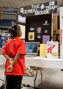 A young exhibitor at last Spring's Connecticut Invention Convention. More than 650 young inventors from grades K-8 participated in the event. (Christopher La Rosa/UConn photo)