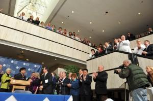 Health Center staff gather around for the bill signing. (Pete Morenus/UConn Photo)