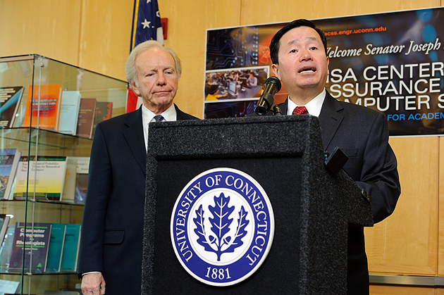 Mun Choi, dean of engineering, introduces U.S. Sen. Joseph Lieberman to an audience of faculty, staff, and students. (Peter Morenus/UConn Photo)