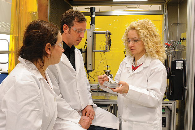 Radenka Maric, Connecticut Clean Energy Fund Professor of Sustainable Energy, right, in the lab with Justin Roller, center, a graduate student and Mirela Dragan, a postdoctoral fellow. (Peter Morenus/UConn Photo)