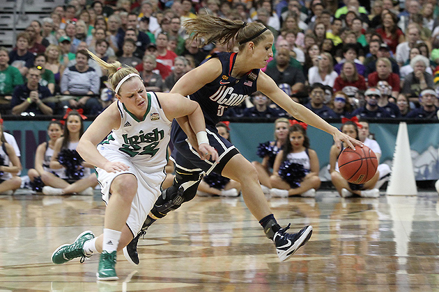 Caroline Doty '13 (CLAS) battles for the ball against Natalie Novosel of Notre Dame at the Pepsi Center in Denver during the NCAA Tournament on Sunday. (Bob Stowell for UConn)