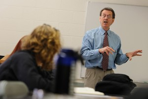 Marcel Dufresne, associate professor of journalism, speaks with students in his investigative reporting class. (Peter Morenus/UConn Photo)