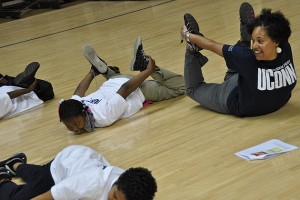UConn student Alicia Waring leads Read & raise participants in yoga exercises. (Shawn Kornegay/UConn Photo)