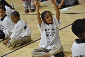 Students from Clark Elementary School do stretching activities in Gampel Pavilion. (Shawn Kornegay/UConn Photo)