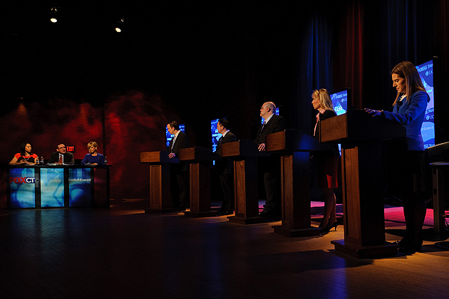 Five democratic candidates for U.S. Senate participate in a debate at at von der Mehden Recital Hall on April 9.  From left on stage are Laurie Perez of FOX CT, Christopher Keating of the Hartford Courant, Alison Morris of FOX CT, and candidates Chris Murphy, William Tong, Matthew Oakes, Lee Whitnum, and Susan Bysiewicz (Peter Morenus/UConn Photo)