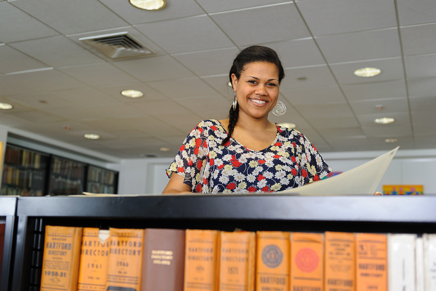 Tekowa Omara-Otunnu '14 (CLAS) at Hartford Public Library. Her internship there includes working with historical documents on the city, as well as tutoring immigrants and refugees in a citizenship program. (Peter Morenus/UConn Photo)