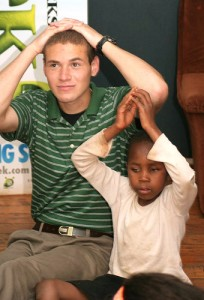 Aaron Hayes '12 (CLAS), with a young burn victim in South Africa.