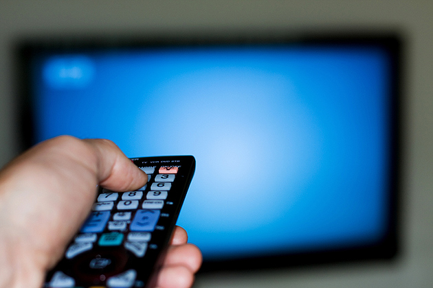 Picture of a Man using a TV Remote Control
