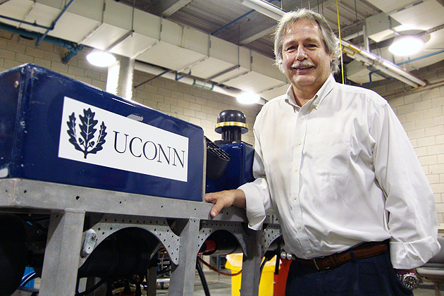 """Ivar Babb, director of the Northeast Undersea Research Technology and Education Center at UConn, with """"Hela,"""" a submersible vessel that will take high-resolution photos of the Long Island Sound seafloor. (Christine Buckley/UConn Photo)"""