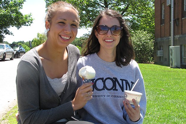 """When they were told the dairy bar was going to stay open later every night, Rebekah Lohners '15 HDFS (left) and Brittany LaRose '14 HDFS said in unison """"That will be great!"""" (Sheila Foran/UConn Photo)"""