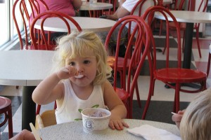 Emily, from Bristol, is about to turn two years old. She was enjoying some pre-birthday ice cream at the Dairy Bar with her grandparents. She  didn't have anything to say about extended hours, but a picture really is worth a 1,000 words. (Sheila Foran/UConn Photo)