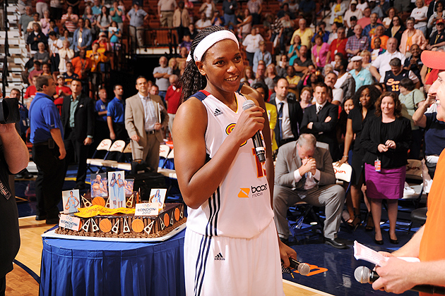 Asjha Jones '02 (BUS) of the Connecticut Sun addresses the crowd at Mohegan Sun Arena during a celebration by the team as she heads off to compete at the 2012 London Olympic Games on the USA Basketball National Team coached by Geno Auriemma. (Copyright 2012 NBAE Photo by Brian Babineau/NBAE via Getty Images)
