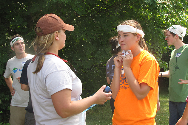 Program coordinator Charlotte Rand, left, and Rachel Runkle from Lebanon answer each other's questions in a 'getting to know you' exercise on the first day. (Sheila Foran/UConn Photo)