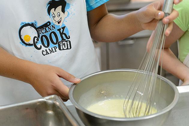 Children make breakfast foods during UCann Cook Camp held at Gelfenbien Commons on July 25, 2012. (Peter Morenus/UConn Photo)