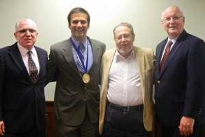 From left: Drs. Ravindra Nanda, Flavio Uribe, Professor Emeritus Charles Burstone and Dean of the School of Dental Medicine R. Lamont MacNeil. (Jennifer Huber/UConn Foundation Photo)