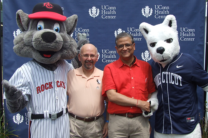 Rocky the Rock Cat, Joseph Fazzino from Virtus Mutual Funds, Dr. Pramod Srivastava, and Jonathan the Husky at the 2012 Cancer Survivors Day. (Donna Hamzy for UConn Health Center)