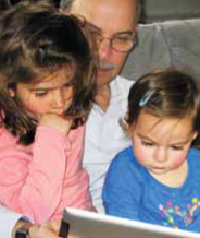 Leslie Loew reads with his grandchildren. (Photo provided by Leslie Loew)